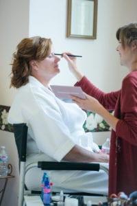 mother of the bride getting her makeup done by rachel jordan beauty
