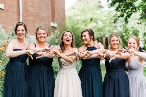 bridesmaids and bride having fun at st als in spokane wedding makeup